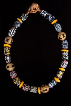 Mostly Ghana beads decorated to resemble  African trade beads (misidentified on website) and brass beads