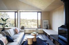Moloney Architects have recently completed a new modern wood home in Invermay, Australia, that's named the 'Two Halves House'. Modern Wood House, Timber House, Living Room Modern, Living Area, Living Spaces, Clad Home, Timber Ceiling, Journal Du Design, Fireplace Design