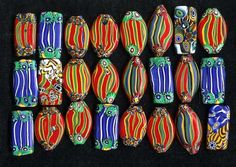 Modern lampworked beads based on old African designs - from THIS BEADIFUL WORLD...