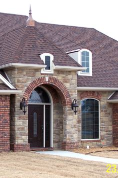 Welcome home entrance with brick arch topped with a caststone keystone