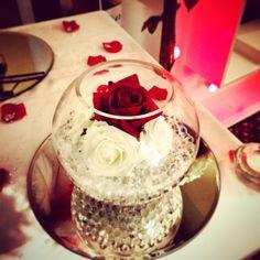 Fish bowl and roses