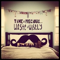 Quote on the wall, pictures, and mustach pilloxs