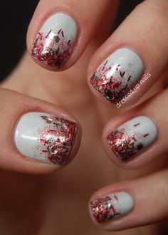 """""""Sooo, what youre seeing here is three coats of OPI My Boyfriend Scales Walls, which I hadnt used before this and am now kind of smitten with. Then I added a coat of Wet n Wild 2% Milk for some sparkly, snowy shimmer. Finally I did a tinsel-y gradient using Pure Ice Sleigh Ride, and voila! It looks like Christmas threw up on my nails and I LOVE IT."""""""