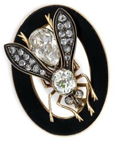 14 karat yellow gold, diamond and enamel 'bee' pin One Old Mine cut diamond approximately .5 carats and one modified pear shaped diamond set 'abdomen' approximately 1.25 carats, wings set with eighteen rose cut diamonds, within a circular black enamel frame.