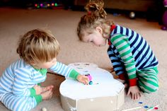 DIY Toddler Toy:  Snowman Drop Box from Fun at Home with Kids