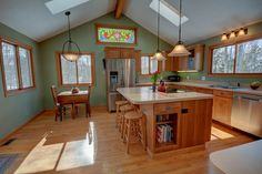 """The Leelanau county home has a kitchen that screams """"please entertain. With Seasonal Views of Lake Leelanau and walking distance to Wineries this home would love to have a new owner. Lake Leelanau, Traverse City Michigan, Wineries, Property For Sale, Distance, Corner Desk, Floor Plans, Walking, Real Estate"""