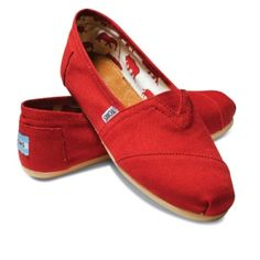 TOMS Red canvas women's classics. Brand new with tags, never worn. Super cute and comfy!! TOMS Shoes