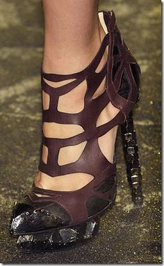 Nicholas Kirkwood for Rodarte Industrial Shoes....  These are very cool looking however I would never be able to walk in them!