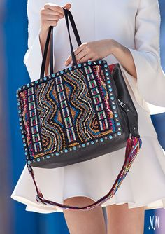 We're escaping to the beach with beaded Rockstud totes by Valentino. This leather carryall is essential for last-minute getaways.