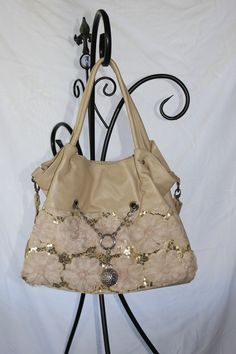 Chains & Lace Handbag in Tan 30.00. Go to jtnmissions.org to order yours today! 100% of the proceeds go to missions local and worldwide.