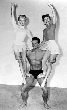 """Steve Reeves, Jane Powell  and Debbie Reynolds a publicity photo for MGM's odd Physical Culture Musical, """"Athena."""" The girls' father ( Louis Calhern) runs a health food store, and he is a patron sponsored by the store in his bodybuilding efforts. [pr]"""