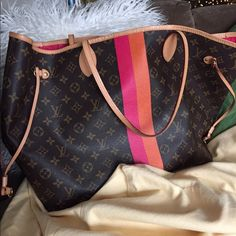Authentic Louis Vuitton Neverfull gm mon monogram Beautiful and so unique.  With receipt/gift receipt/dustbag. No initials just orange and pink stripe with pink interior Louis Vuitton Bags Totes
