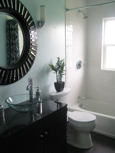 small style, A 1944 bathroom update.  Light blue walls, vessel sink, and white brick style shower., 1944 bathroom update.  Making a small bathroom that is still stylish.  , Bathrooms Design