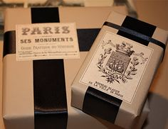 Kraft paper, black ribbon, Classic-vintage label style.  Quite tasteful ~ ! JK
