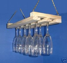 Make from barn lumber?  Hanging Wine Glass Rack Stemware Holder 15 inch Item  136. $19.99, via Etsy.