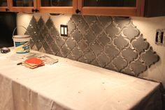 DIY kitchen backsplash. Love the tile design