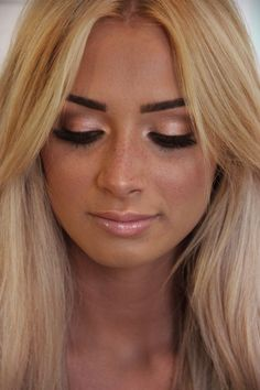 peach and brown eye shadow with nude color lips.