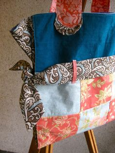 This bag was designed to accommodate quite a few items on the way back from the library. Materials 12 charm squares or 5 inch squares (6 for each side of the bag) Scrap fabric for the top of the ba…