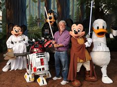 "AUGUST 22, 2010  Filmmaker George Lucas meets ""Star Wars""-inspired Disney characters at Walt Disney World Resort in Florida  and he is so thrilled...."
