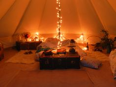 I like it that the bed is on the floor, also love the antique suitcases for storage, AND the twinkle lights.