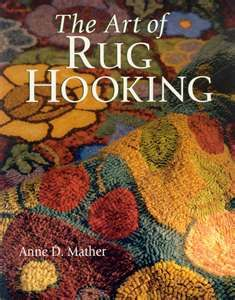 The art of Rug hooking. It's like painting on fabric with  strips of wool pieces.