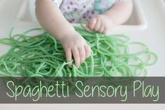 Spaghetti sensory play with a 7 month old baby - important for brain development and scientific understanding.