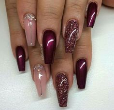 Glossy Maroon Coffin Nails with Glitter. Maroon color is or winners and when they are embellished with glitter and rhinestones, they make a worth trying nail art.