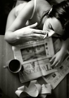 woman | smoking | cigarette | coffee | breakfast | newspaper | routine | early morning | lazy | relaxing | Sunday morning coffee and papers | birds eye view | great angle | smoke |