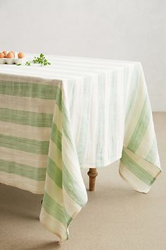 Awning Stripe Tablecloth #anthropologie #pintowin A toned down look with umbrellas and candle holders.
