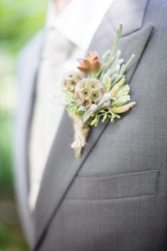 Groom's grey suit with groom's boutonnière from a wedding at RT Lodge in Maryville, TN