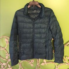 UNIQLO teal puffer coat/jacket. NEVER WORN real, super cute. light weight. portable. NEVER WORN UNIQLO Jackets & Coats Puffers