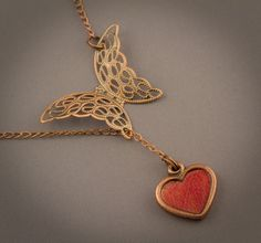 take a closer look, the heart is an actual autumn leaf layered in jewelers resin by Shireen Nadir at thebluebrick.ca