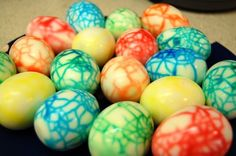 dinosaur eggs! just crack the shells of hard-boiled eggs then dip in Easter egg dye  viola! definitely doing these as deviled eggs at Graysons Dinosaur Train themed birthday party!