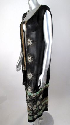 1920's Sheer Silk Beads, Sequins & Gold Thread Tie Front Coverup Flapper Dress. The bead work on this piece is amazing! It has black & white beads, gold sequins & gold threading as well as green horizontal ribbons around the bottom. It has an open front that ties at the hip. Sideway