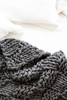 Chunky and absolutely fabulous, this arm knit basketweave blanket, which takes only a handful of hours to make, will soon be the envy of everyone in your life.