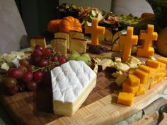 Halloween Cheese Board cut cheese in casket and cross shapes