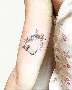 Shell tattoo on the right inner arm. Tattoo artist: Luiza Oliveira