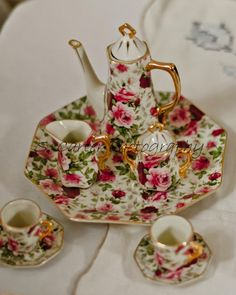 miniature tea Set I have one in black and pink.