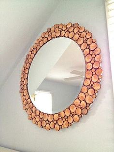 Make: A circular mirror with wood slices all around. I used an Ikea KOLJA mirror adhered to plywood and glued wood slices all around: I love all the different sizes, tones and patterns: Part of a little Master Bedroom makeover but more importantly fills a quirky space where the roof eave cuts into the wall:... Read more