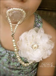 Look at how fancy - until the strand snaps and your baby chokes on a pearl... I need to find a safer way to recreate it!