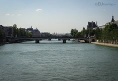 The River Seine as it flows beneath the Pont du Carrousel and alongside the Louvre Museum.  Learn more; www.eutouring.com/images_river_seine.html