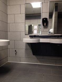 Daltile Exhibition series / EX10 Fray 12x24 on walls with EX04 Dark Gray 12x24 unpolished finish on floors.  Schluter stainless steel cove.