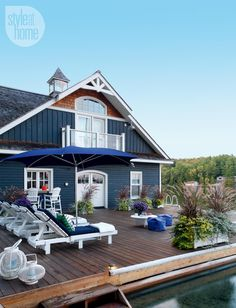 tour: Nautical boathouse The cottage exterior—The huge dock is a dreamy spot for lounging and socializing all day long.The cottage exterior—The huge dock is a dreamy spot for lounging and socializing all day long. Exterior House Colors, Exterior Paint, Beach Cottage Exterior, Lakeside Cottage, Coastal Cottage, Style At Home, Blue Siding, Deck Colors, Haus Am See