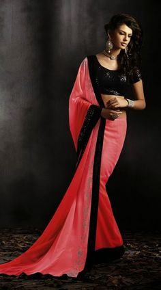 Exclusive pink georgette border saree which is decked with stone work in the horizontal panel and contrast black patch on the border. Contrast black blouse piece attached with this attire. The blouse of this saree can be stitched in the maximum bust size of 42 inches.