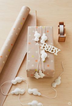 "Baby gift wrap ideas: Showered with love When we give baby shower gifts, we want the ""aaaaw."" A Hallmark Stylist shows baby gift wrap ideas using basic craft supplies, common gifts, and wrap. Baby Shower Wrapping, Baby Gift Wrapping, Baby Gift Box, Baby Box, Creative Gift Wrapping, Present Wrapping, Creative Gifts, Baby Shower Gifts, Baby Gifts"