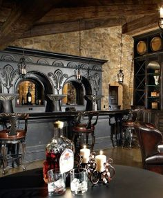 The rich gothic bar and stone wall look amazing!