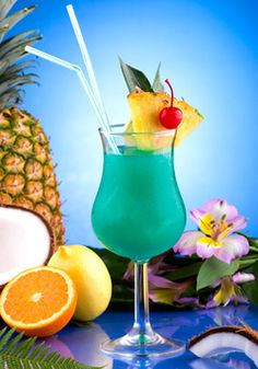 Picture of Blue Hawaiian cocktail surrounded by tropical fruits. Rum, pineapple juice, coconut milk and blue curacao garnished with slice of pineapple and maraschino cherry. Most popular cocktails series. stock photo, images and stock photography. Blue Curacao, Blue Hawaiian Cocktail, Hawaiian Cocktails, Blue Cocktails, Blue Hawaiian Punch, Hawaiian Luau, Bar Drinks, Cocktail Drinks, Alcoholic Drinks