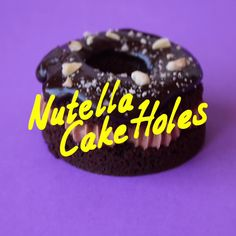 Chocolate cake donut with a nutella buttercream centre, a drizzle of chocolate sauce topped with crushed hazelnu