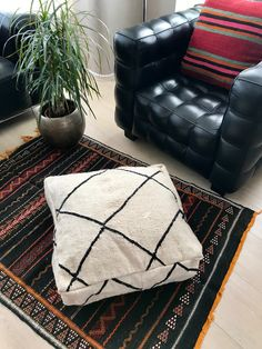 White and black Moroccan Kilim pouf made from vintage kilim rugs.  60 x 60 x 20 cm/ 24 x 24 x 8 inch.  100% wool and handmade.  Each pouf is Unique, with only one available.