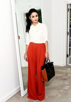 Wide legged red pants with a white pussybow blouse.